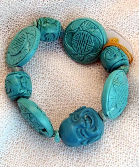 Armband mit Türkisen, Magnesiten und tibetischen Glückssteinen